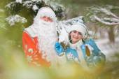 Russian Christmas characters: Ded Moroz (Father Frost) and Snegurochka (Snow Maiden) with gifts bag — Stock Photo