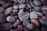 Single  heart on black pebble stones — Foto Stock