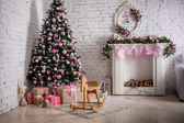 Image of chimney and decorated xmas tree with gift — Stock Photo