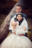 Portrait of happy groom and the pretty bride in autumn park — Stock Photo