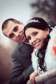 Portrait of happy groom and the prettybride in autumn park — Stock Photo