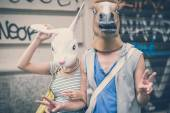 Horse and rabbit mask couple of friends young  man and woman — Stock Photo