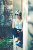 Hipster woman with headphones — Stock Photo