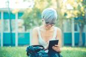 Young beautiful short blue hair hipster woman using tablet — Photo