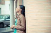 African woman listening music earphones — Stock Photo