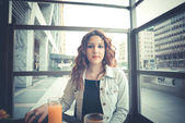 Young beautiful hipster woman with red curly hair — 图库照片