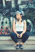 Hipster woman with headphones music — Stock Photo