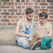 Couple of friends young  man and woman using laptop — Stock Photo #53983505