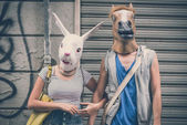 Horse and rabbit mask couple of friends young  man and woman — Foto Stock