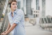 Young model hansome blonde man with headphones — Stock Photo