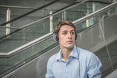 Young model hansome blonde man headphone and notebook — Stock Photo