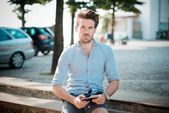 Young handsome hipster modern man outdoor using tablet — Stock Photo