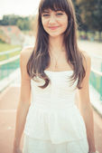 Beautiful young woman with white dress — Stock Photo