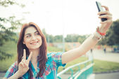 Beautiful young hipster woman using smartphone — Stock Photo
