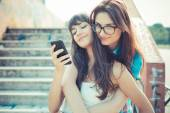 Beautiful hipster young women sisters friends — Stockfoto