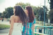 Beautiful hipster young women sisters friends — Stock Photo