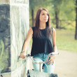 Young beautiful brunette straight hair woman using bike — Stock Photo #56226491