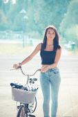 Young beautiful brunette straight hair woman using bike — Stock Photo