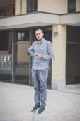 Handsome hipster casual multitasking modern man listening music  — Stock Photo