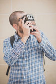 Handsome hipster casual multitasking modern man with vintage cam — Stockfoto