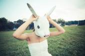 Rabbit mask absurd beautiful young woman with white dress — Stock Photo