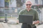 Handsome middle aged man using notebook — Stock Photo