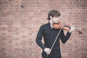Young handsome blonde violinist — Stock Photo