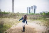 Beautiful woman dancing in a desolate landscape — Stock Photo