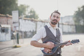 Handsome big moustache hipster man playing mandolin — Stock Photo