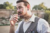 Handsome big moustache hipster man smoking cigarette — Stock Photo