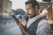 Handsome big moustache hipster man using tablet — ストック写真