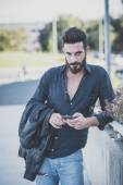 Bearded man using smartphone — Stock Photo