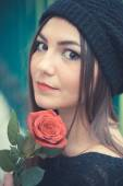 Young beautiful  woman with rose — Stock Photo