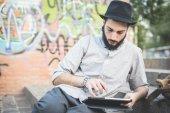 Modern man using digital tablet — Stock Photo