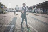 Hipster man playing mandolin — Stock Photo