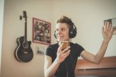 Young lesbian stylish hair style woman listening to music — Stock Photo