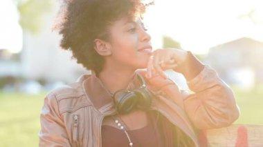 Arican girl with headphones — Stock Video