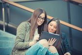 Two young girls using tablet — Stock Photo