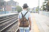 Hipster man waiting on railway station — Stock Photo