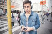 Young man with headphones listening music — Stock Photo
