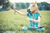 Horse mask woman using technology — Stock Photo