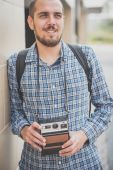 Modern man with vintage camera — Stock Photo