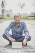 Modern man using tablet — Stock Photo