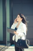 Business woman using tablet — Stock Photo
