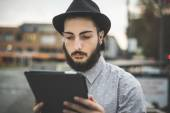 Hipster gay modern man using tablet — Stock Photo
