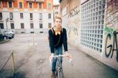 Hipster girl with bike — Stock Photo