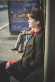 Hipster girl waiting for bus — Stock Photo