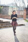 Pretty woman listening music — Stock Photo