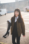 Asian hipster woman in city — Stock Photo