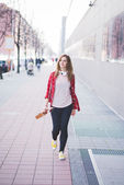 Hipster girl in city — Stock Photo